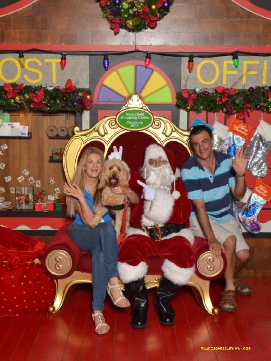 Sharon Chapman with husband Giuseppe and Assistance Dog Kiri with Santa