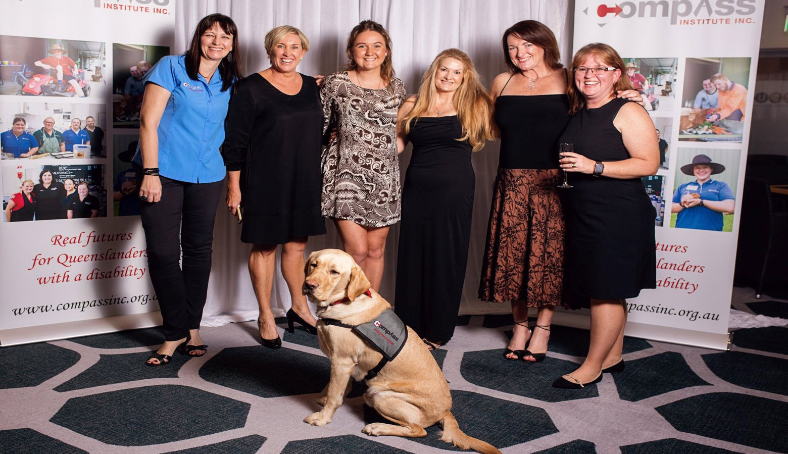 Sharon Chapman in group photo of volunteers at the Compass Gala