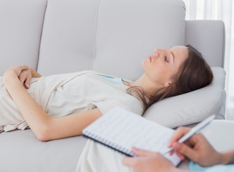 Woman lying on couch relaxed and enjoying Hypnotherapy session