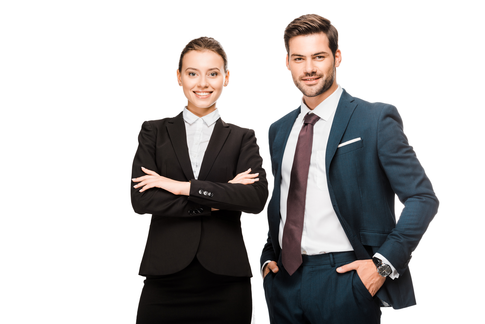 Man and woman at work smiling at camera and dressed in corporate clothes